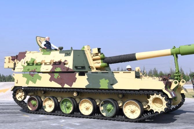 Prime Minister Narendra Damodardas Modi aboard a tank at Larsen and Toubro's armoured systems complex facility at Hazira, Gujarat, January 19, 2019