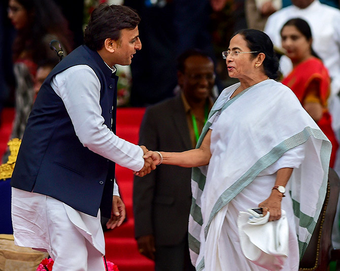 West Bengal Chief Minister Mamta Banerjee greets Samajwadi Party leader Akhilesh Yadav in Bengaluru. Photograph: Shailendra Bhojak/PTI Photos