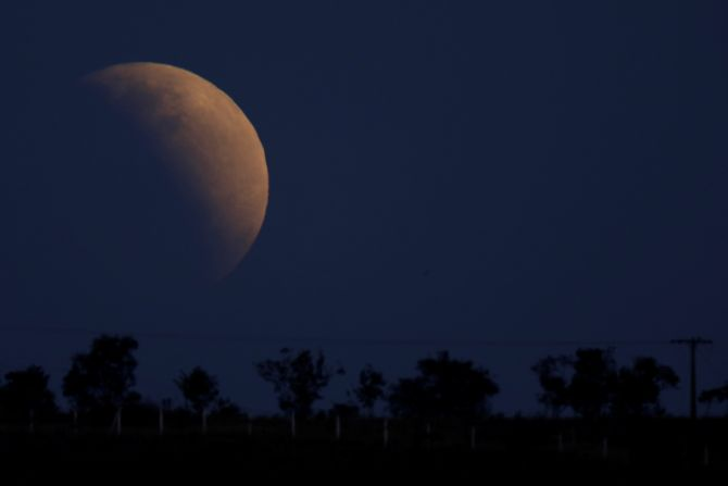PHOTOS: Partial lunar eclipse graces the sky