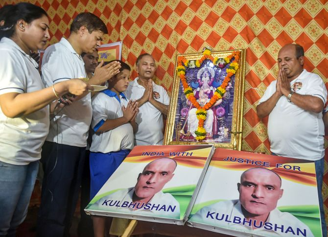 Commander Kulbhushan Jadhav (retd)'s childhood friends and their families in Mumbai celebrate the International Court of Justice's verdict, July 27, 2019. Photograph: Mitesh Bhuvad/PTI Photo
