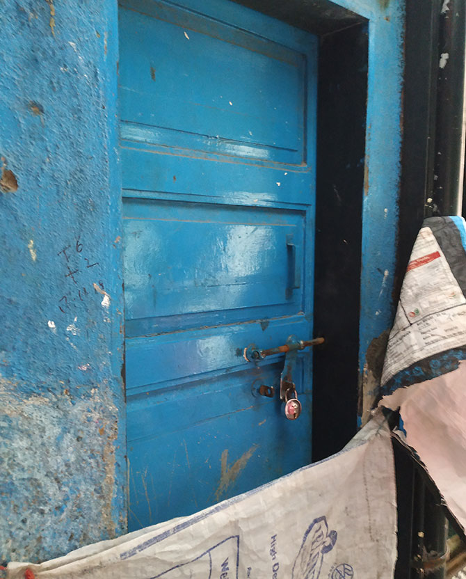 The locked blue door to the home the couple lived in.