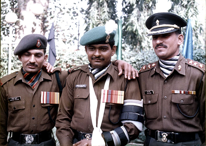 Param Vir Chakra awardees then Rifleman Sanjay Kumar, left, and then Grenadier Yoginder Yadav, centre, with Mahavir Chakra awardee then Lieutenant Balwan Singh, right. Grenadier Yadav and Lieutenant Balwan Singh were in the commando platoon that led the final assault on Tiger Hill. Their bravery that night is the stuff of legend. Photograph: Rediff.com