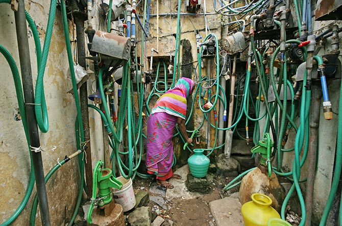 A woman uses a hand pump to fill up a container with drinking water in Chennai. Photograph: P Ravikumar/Reuters.