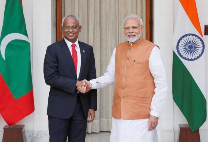 Maldives President Solih and India's PM Modi shake hands