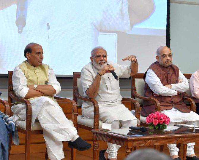 Prime Minister Narendra Damodardas Modi, flanked by Defence Minister Rajnath Singh, left, and Home Minister Amit Anilchandra Shah. Photograph: Press Information Bureau