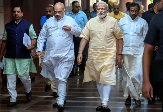 Prime Minister Narendra Damodardas Modi, Union Home Minister and Bharatiya Janata Party President Amit Anilchandra Shah and other BJP leaders leave after an National Democratic Alliance meeting at the Parliament library in New Delhi, June 16, 2019. Photograph: Shahbaz Khan/PTI Photo