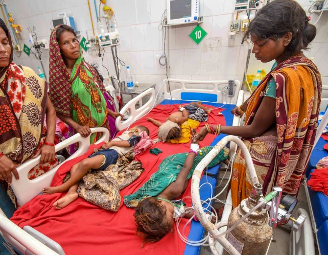 Children showing symptoms of acute encephalitis syndrome undergoing treatment at the Sri Krishna Medical College and Hospital in Bihar's Muzaffarpur. Photograph: PTI Photo