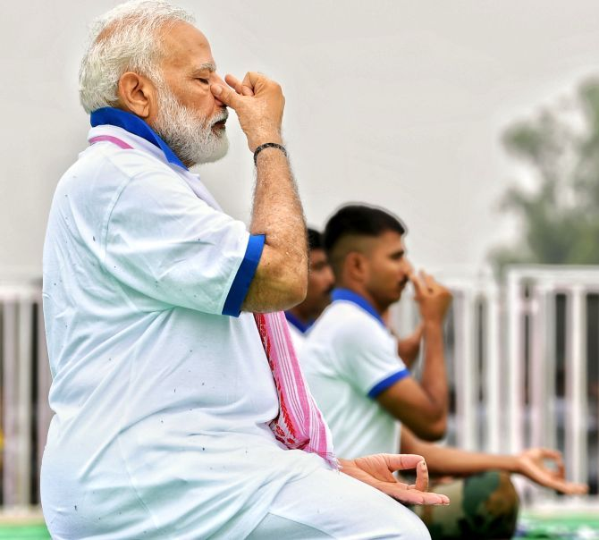 Prime Minister Narendra Modi performs an asana during a Yoga Day event