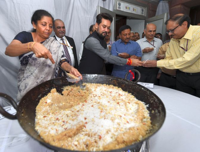 Finance Minister Nirmala Sitharaman and Minister of State for Finance Anurag Thakur at the Halwa ceremony to mark the beginning of printing of budgetary documents in New Delhi, June 22, 2019. Photograph Shahbaz Khan/PTI Photo