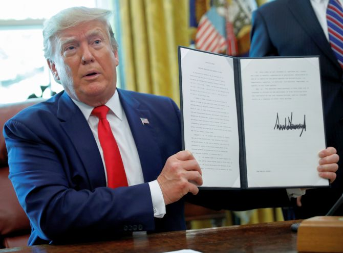 Trump signs 'hard-hitting sanctions' against Iran