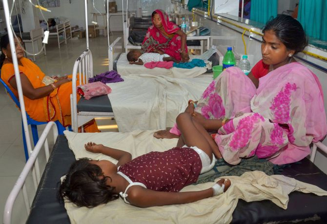 A mother sits as her child is treated for acute encephalitis syndrome at Sri Krishna Medical College and Hospital. Photograph: PTI Photo