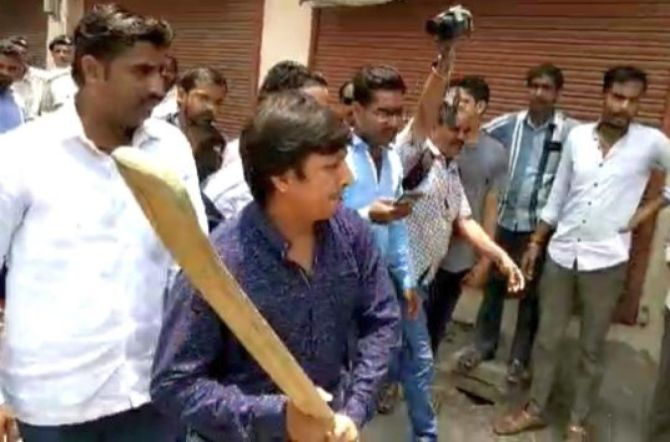 WATCH: BJP's Vijayvargiya's son beats officer with bat