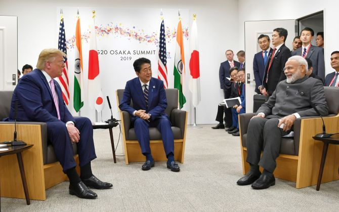 Prime Minister Narendra Damodardas Modi with US President Donald J Trump and Japanese Prime Minister Abe Shinzo meet ahead of the G-20 summit in Osaka, January 28, 2019.