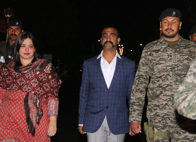 Wing Commander Abhinandan Varthaman, centre, flanked by a Pakistan Ranger named Faisal, to his left,  and Pakistan diplomat Fareeha Bugti, to his right, at the Wagah border, March 1, 2019. Bugti was the first woman from Balochistan to join the Foreign Service of Pakistan in 2005. Photograph: PTI Photo