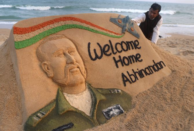 Sand artist Sudarsan Pattnaik with a sand sculpture of Wing Commander Abhinandan Varthaman at the beach in Puri, March 1, 2019. Photograph: PTI Photo