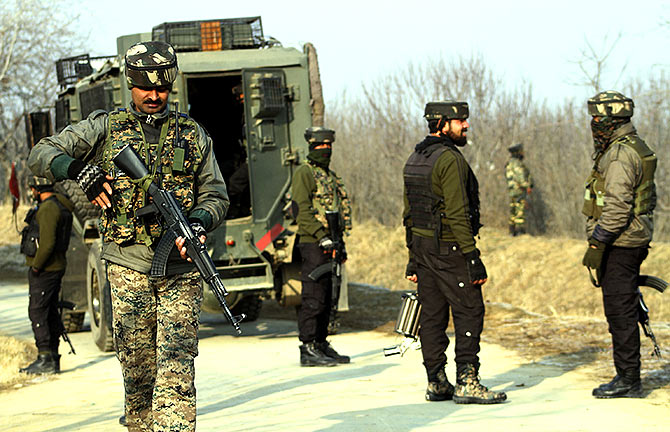 Soldiers at the site of an encounter with terrorists in Pulwama, south Kashmir, December 28, 2018. Photograph: Umar Ganie for Rediff.com