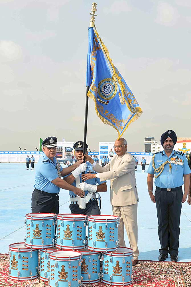 Air Chief Marshal Birender Singh Dhanoa, seen right, as President Ram Nath Kovind, supreme commander of the armed forces, presents colours to Air Force Station, Hakimpet, and 5 Base Repair Depot at the air force station, Sulur, Coimbatore, March 4, 2019. Photograph: Rashtrapati Bhavan