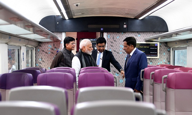 Prime Minister Narendra Damodardas Modi inspects the Vande Bharat Express at New Delhi Railway Station on February, 15, 2019. Union Minister for Railways and Coal Piyush Goyal and Chairman, Railway Board, Vinod Kumar Yadav are also seen. Photograph: ANI Photo