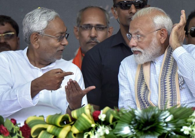 Bihar Chief Minister Nitish Kumar with Prime Minister Narendra Damodardas Modi at an election rally.  Photograph: PTI Photo