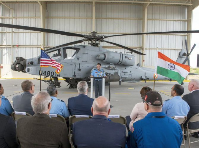 Air Marshal Aravindra Singh Butola speaks at the handing over ceremony at the Boeing's helicopter production facility at Mesa, Arizona.
