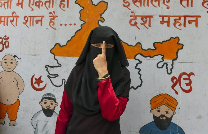 A young voter shows her inked finger after voting in the 6th phase of the Lok Sabha election May 12, 2019. Photograph: PTI Photo