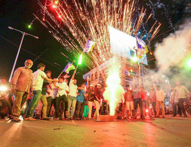 YSR Congress activists in Vijayawada celebrate the party's victory in the assembly and Lok Sabha elections. Photograph: PTI Photo