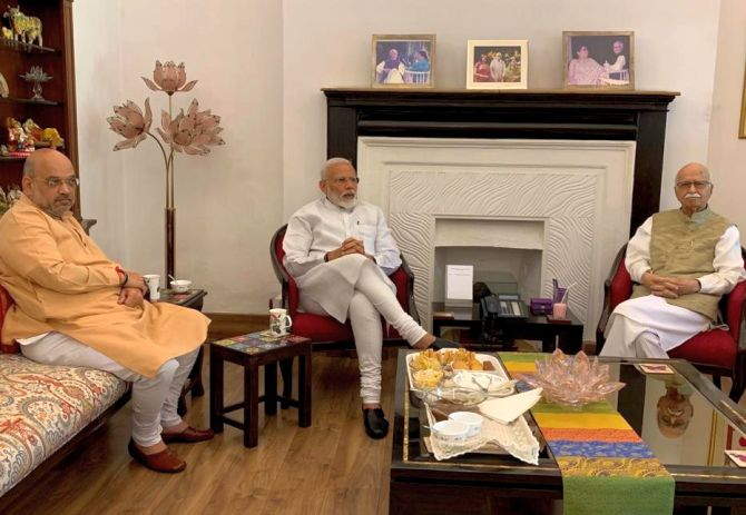 After massive victory, Modi, Shah meet Advani, Joshi