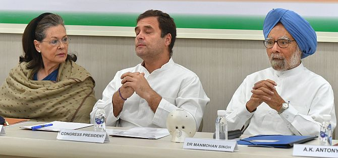 Congress national President Rahul Gandhi, centre, flanked by Sonia Gandhi, the Congress MP from Rae Bareli, left, and former prime minister Dr Manmohan Singh at the Congress Working Committee meeting, May 25, 2019