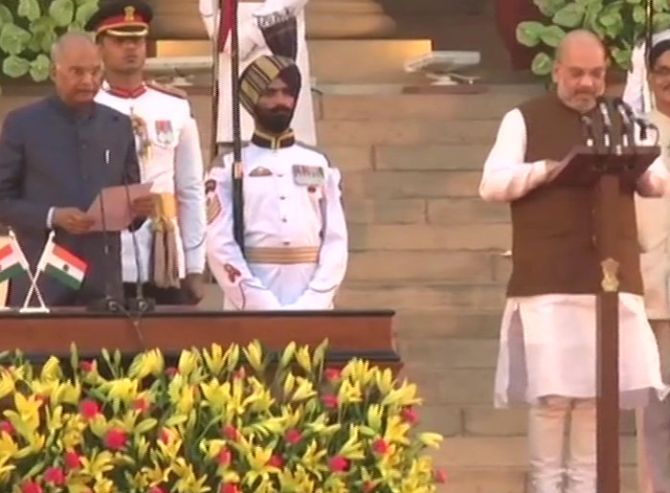 Amit Anilchandra Shah takes the oath of office as a Caibinet minister and swears to defend the Constitution of India. Photograph: Vijay Verma/PTI