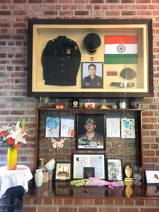 Photographs, uniforms, medals that belonged to martyred Major Akshay Girish.