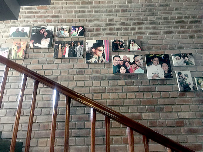 The staircase is lined with happy pictures of the young Major Akshay Girish. 'He was a remarkable boy,' says Mrs Girish.
