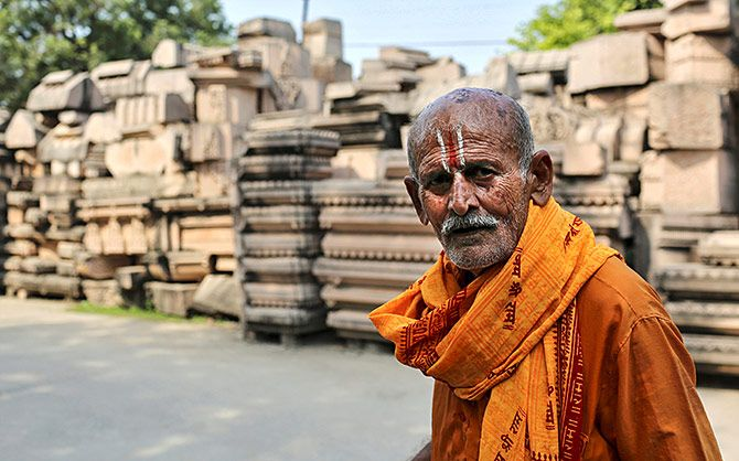 A man walks past the pillars that the Vishwa Hindu Parishad says will be used to build a Ram temple in this photograph taken on October 22, 2019. Photograph: Danish Siddiqui/Reuters