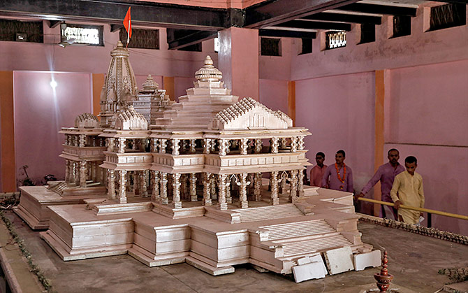 Devotees look at a model of the proposed Ram temple that Hindu groups want to build at the disputed Ram Janambhoomi/Babri Masjid site in Ayodhya, in this photograph taken October 22, 2019. Photograph: Danish Siddiqui/Reuters