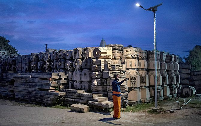A devotee takes a selfie with the pillars that the VHP says will be used to build a Ram temple in this picture taken on October 21, 2019. Photograph: Danish Siddiqui/Reuters