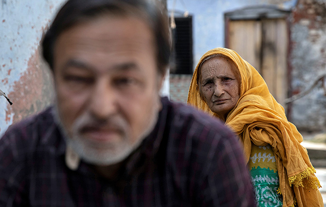 Zaibunissa, whose husband was killed in the riots following the Babri Masjid demolition on December 6, 1992, with her son Mohammed Shahid in Ayodhya, in this picture taken on October 22, 2019. Photograph: Danish Siddiqui/Reuters