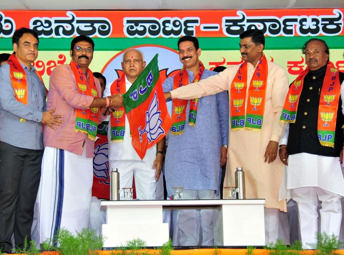 16 disqualified K'taka MLAs join BJP; 13 get tickets