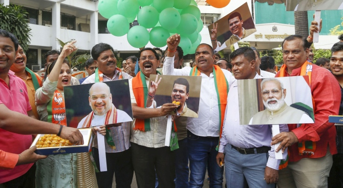 Bharatiya Janata Party supporters celebrate the formation of a BJP government outside the party headquarters in Mumbai, November 23, 2019. Photograph: PTI Photo
