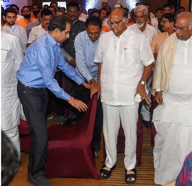 Sharad Pawar, Uddhav Thackeray and senior Congress leader Mallikarjun Kharge with Nationalist Congress Party, Congress and Shiv Sena MLAs. Photograph: Mitesh Bhuvad/PTI Photo