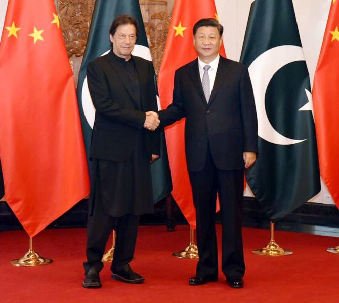 Chinese President Xi Jinping, right, with Pakistani Prime Minister Imran Khan in Beijing, October 9, 2019.