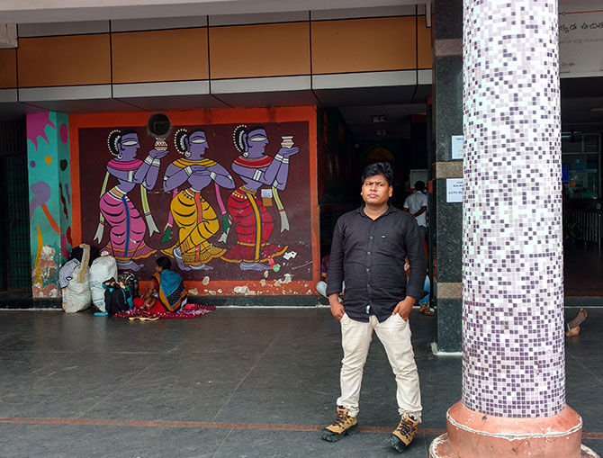On World Tourism Day last month, Visakhapatnam in Andhra Pradesh was awarded the most tourist friendly railway station in India by the central government. A man waits outside the entrance with a mural on the station wall behind him. Photographs: Rediff.com