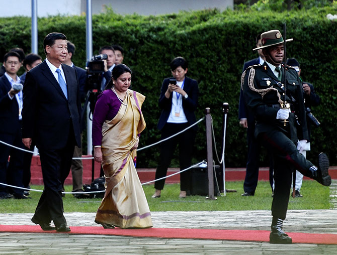 Nepal's President Bidhya Devi Bhandari and China's President Xi Jinping inspect an honour guard at the welcome ceremony at the Tribhuvan international airport in Kathmandu, October 12, 2019. Photograph: Prakash Mathema/Pool via Reuters