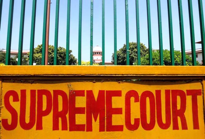 SC reserves Ayodhya order after high drama in court