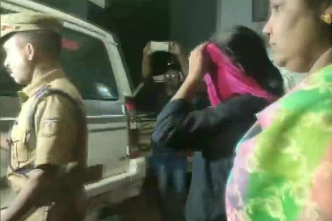 Jollyamma Joseph being arrested in connection with the deaths of six members of a family over a period of 14 years in Koodathai village, Kozhikode district, Kerala. Photograph: ANI