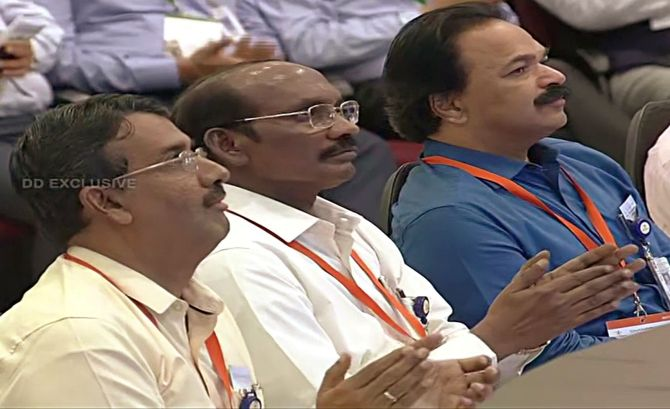 ISRO chief K Sivan along with scientists at ISRO office in Bengalurutors