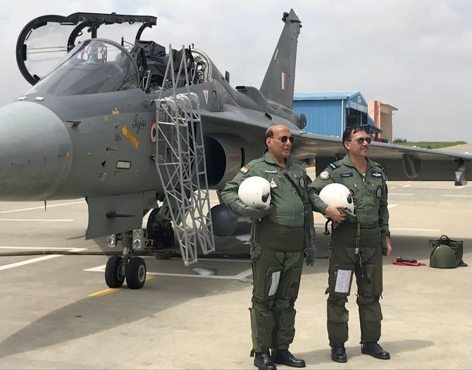 PHOTOS: Rajnath becomes 1st Def Min to fly in Tejas