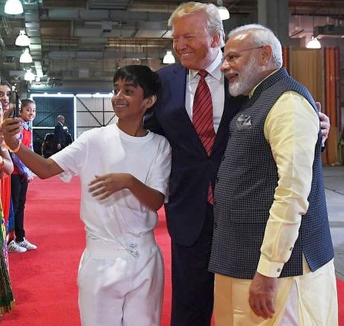 Prime Minister Modi and President Trump take a selfie with a child before the Howdy, Modi event in Houston, September 22, 2019. Photograph: www.narendramodi.in