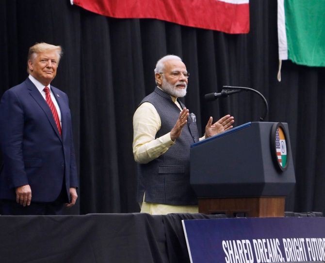 U.S. President Donald Trump looks on as Indian Prime Minister Narendra Modi speaks during a Howdy, Modi rally