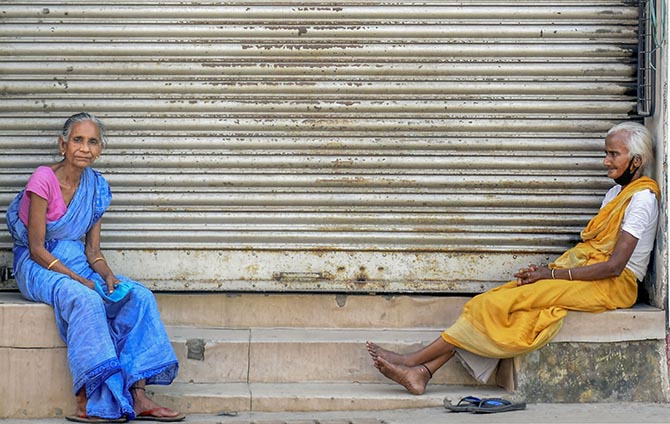 Homeless women sit outside a closed shop in Guwahati, April 7, 2020. Photograph: PTI Photo