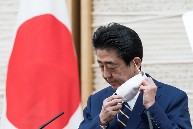 Japan's PM says impossible to hold Olympics