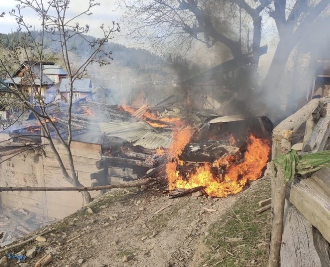 A car on fire after the Pakistan army shelled a village in Kupwara in the Kashmir valley. Photograph: Umar Ganie
